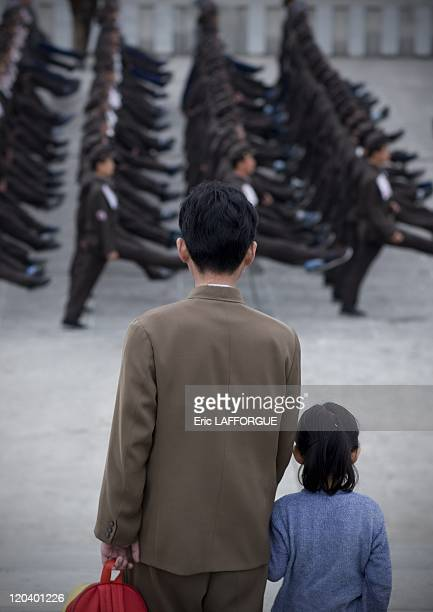 Father and daughter watching North Korean Army Parade in Pyongyang North Korea North Korea is the most militarised country in the world According to...