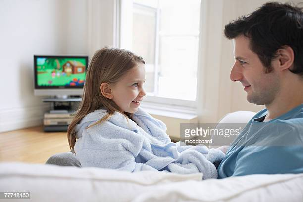 Father and Daughter Watching Television in Living Room