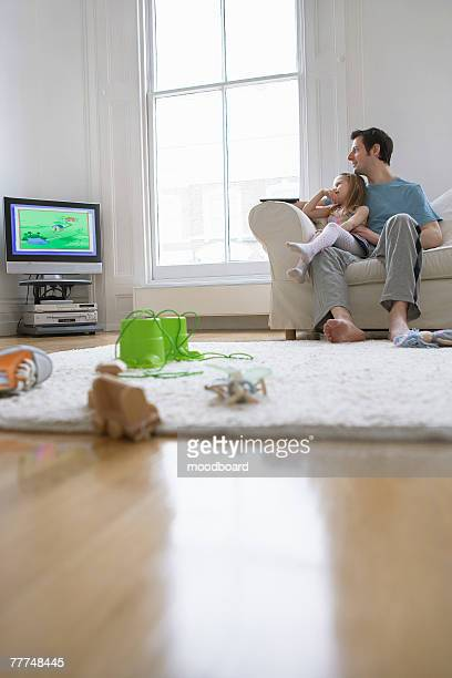 Father and Daughter Watching Television
