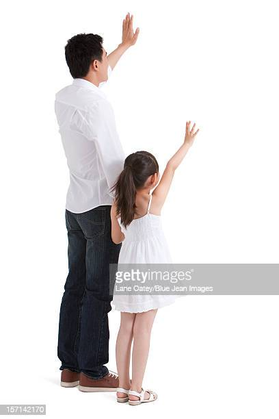 Father and daughter waving to the front