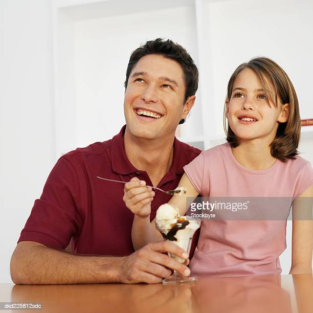 Father and daughter (9-10) with an ice-cream