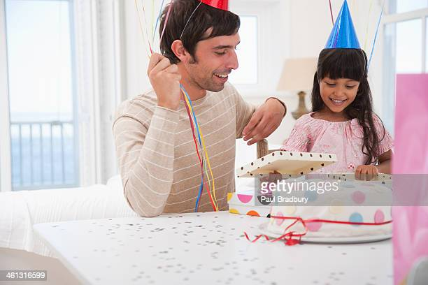 Father and daughter with birthday presents and balloons