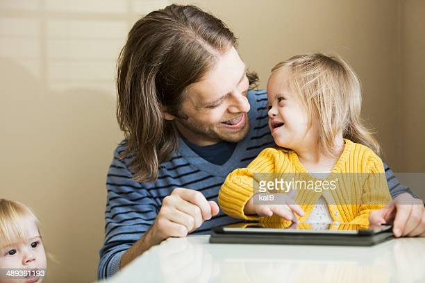father and daughter with down syndrome - down syndrome stock pictures, royalty-free photos & images