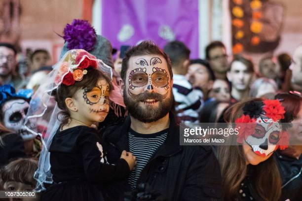Father and daughter with faces painted as the Catrina the Mexican traditional representation of death pictured ahead of a Catrina contest as part of...
