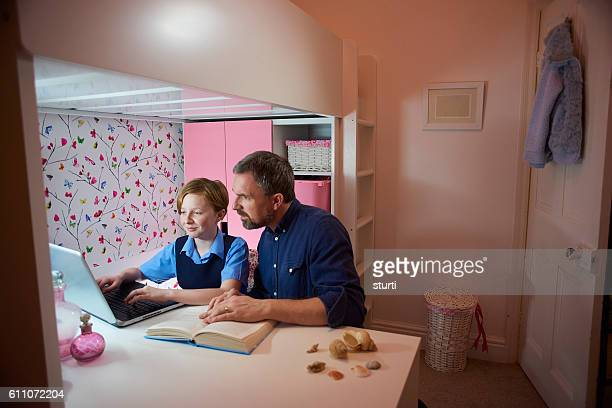 father and daughter with homework