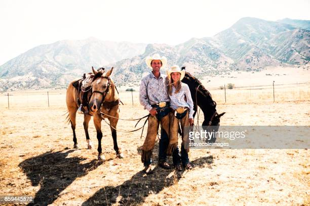 father and daughter with horses - appaloosa stock pictures, royalty-free photos & images