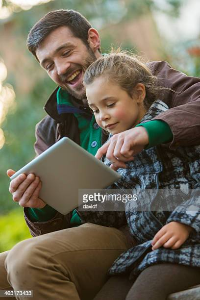 Father and Daughter With Tablet Computer