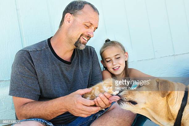 Father and daughter with their pets.