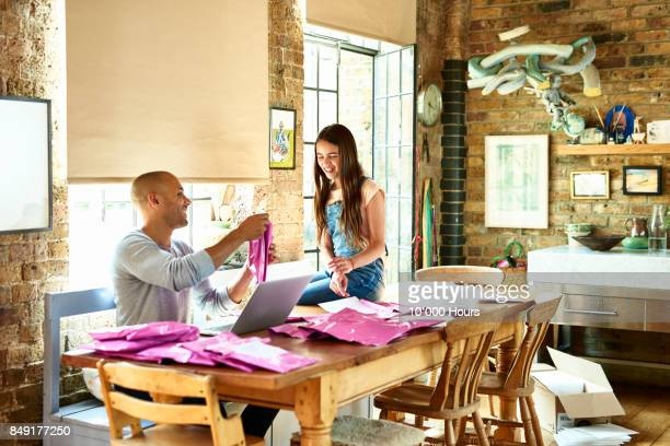 Father and daughter working at home