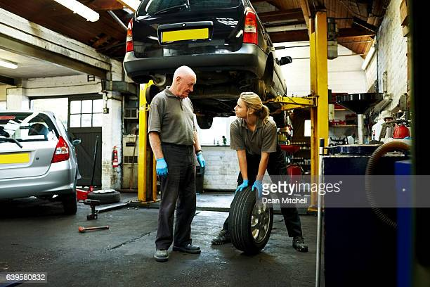 Father and daughter working in auto repair shop