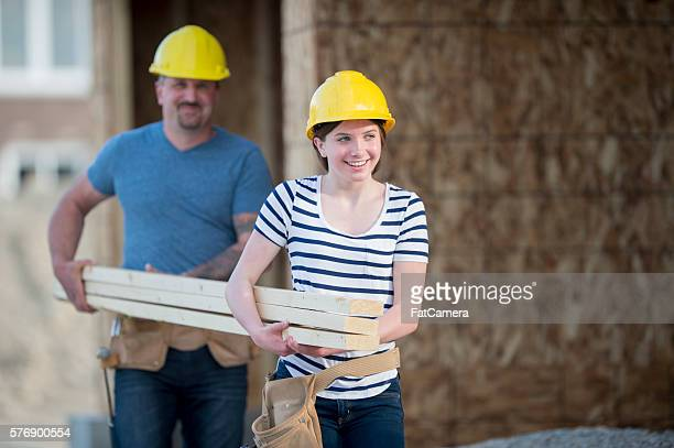 Father and Daughter Working on Site