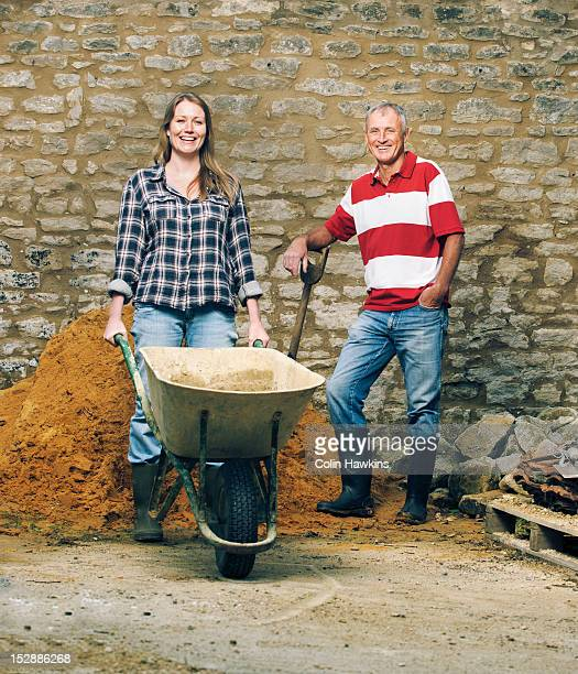 father and daughter working together - colin hawkins stock pictures, royalty-free photos & images
