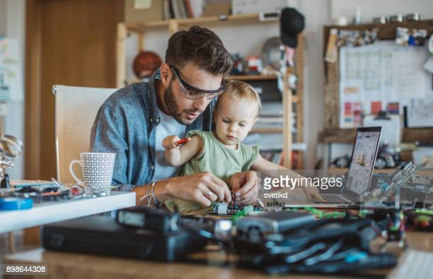 Father and daughter working together