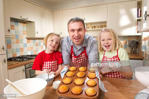 Father and Daughters Baking Cupcakes