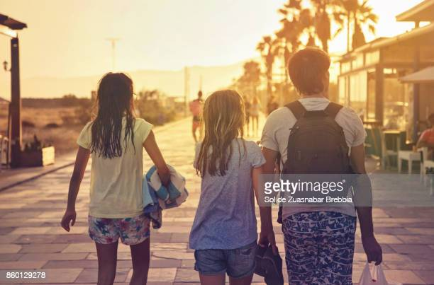 father and daughters coming back from the beach at sunset - hot high school girls stock photos and pictures