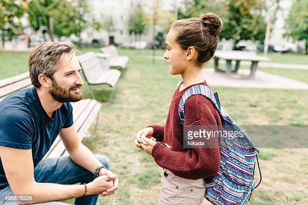 father and daughters talking after school