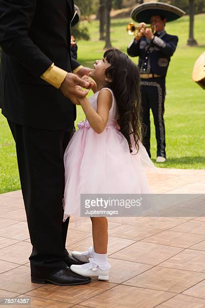 Father and girl dancing at quinceanera