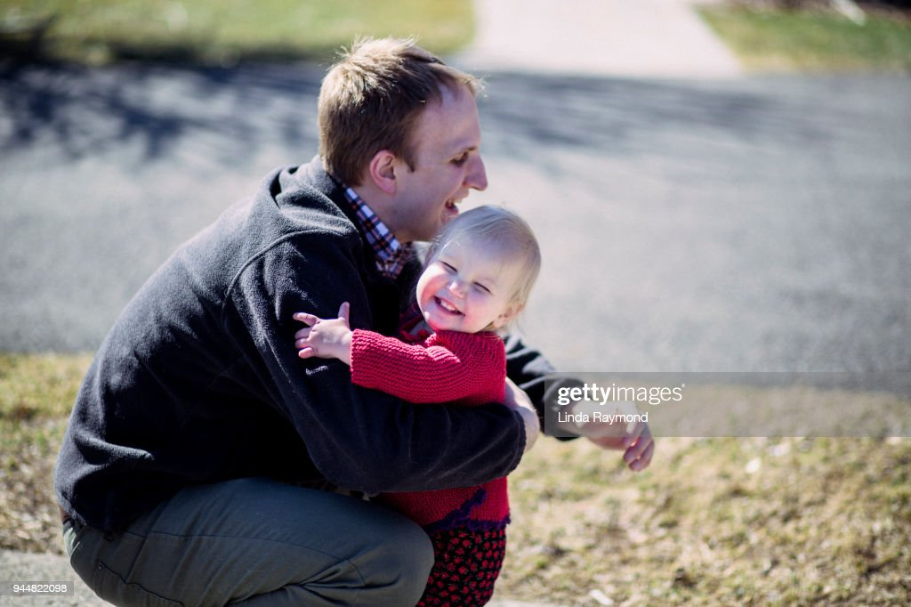 Father and her little girl playing together : Stock Photo