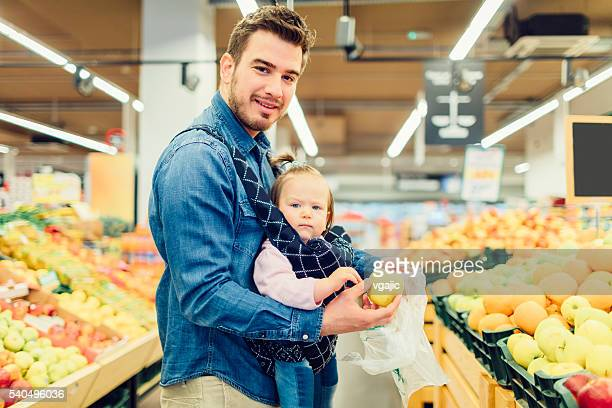 Father And His Baby Daughter Groceries Shopping