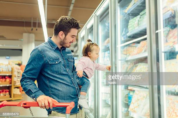 Father And His Baby Daughter Grocery Shopping