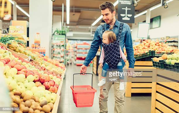 Father And His Baby Daughter In Groceries Shopping