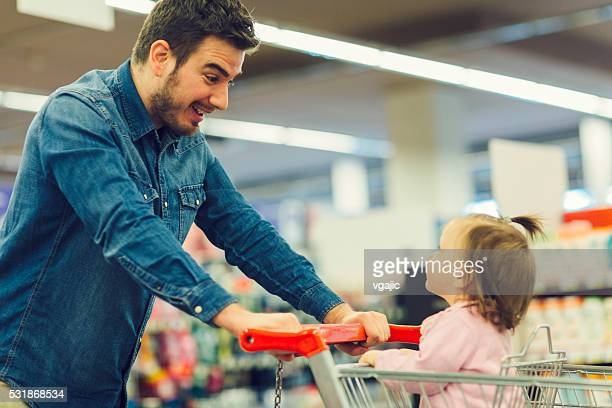 Father And His Baby Daughter In Shopping