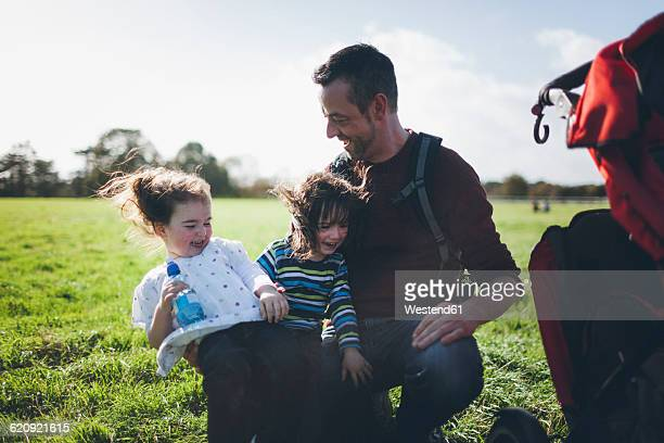 Father and his children having fun in the nature