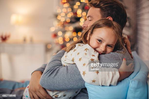 father and his cute daughter in front of christmas three. - 6 7 years photos stock photos and pictures