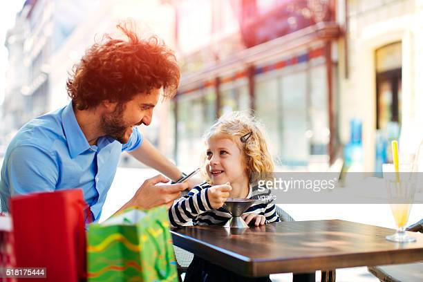 Father And His Daughter In Cafe Together.
