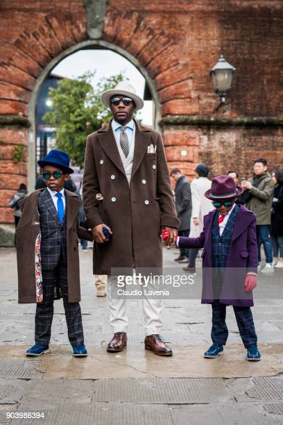 A father and his kids wearing gentleman outfit are seen during the 93 Pitti Immagine Uomo at Fortezza Da Basso on January 10 2018 in Florence Italy