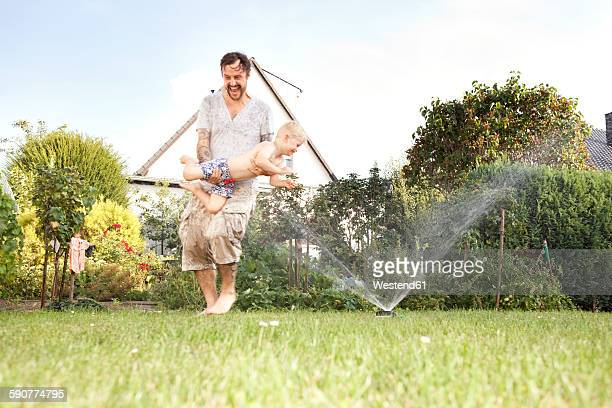 Father and his little son having fun together in the garden