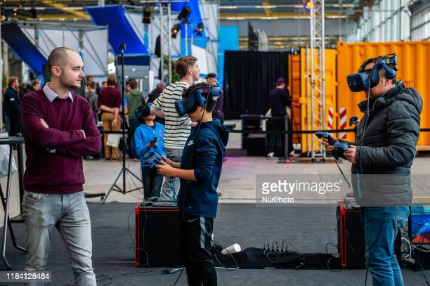 A father and his son are trying virtual reality during the Bright Day Festival in Amsterdam on November 23rd 2019