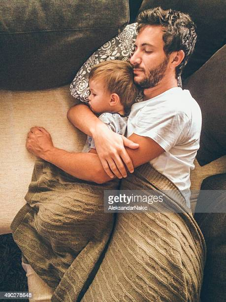 Father and his son having a nap