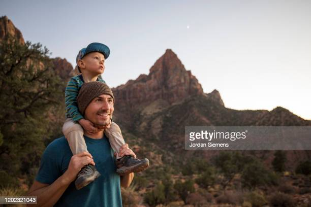 a father and his son hiking a scenic trail - st. george utah stock pictures, royalty-free photos & images