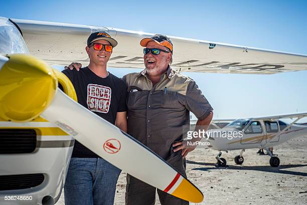 Father and his son near aircraft as participants of Flyin competitions on Saturday May 28 in Uis Namibia Sixteen aircraft took part in the...