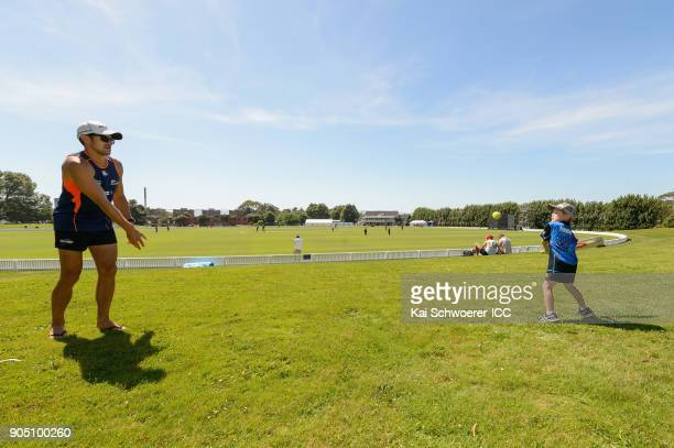 A father and his son play backyard cricket during the ICC U19 Cricket World Cup match between Bangladesh and Canada at Bert Sutcliffe Oval on January...