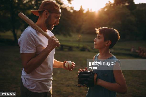 Father and his son playing baseball