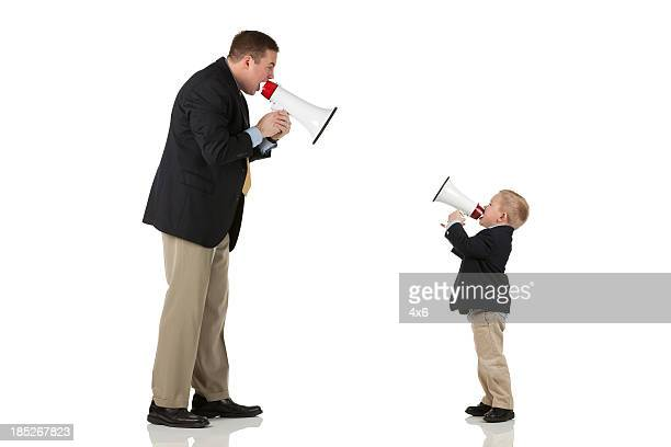 Father and his son shouting into bullhorns
