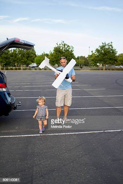 Father and his toddler prepare to fly RC plane