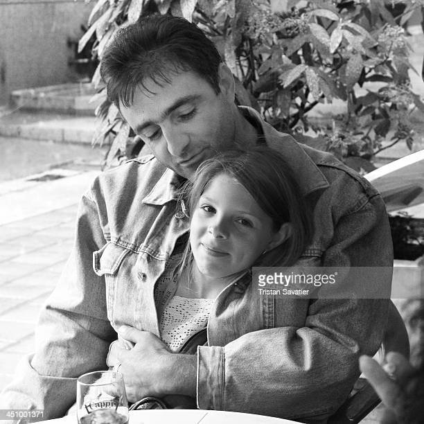 CONTENT] Father and his young daughter sitting at a Cafe in Vratsa family people man parenting girl child kid sitting affection love dad fatherhood...