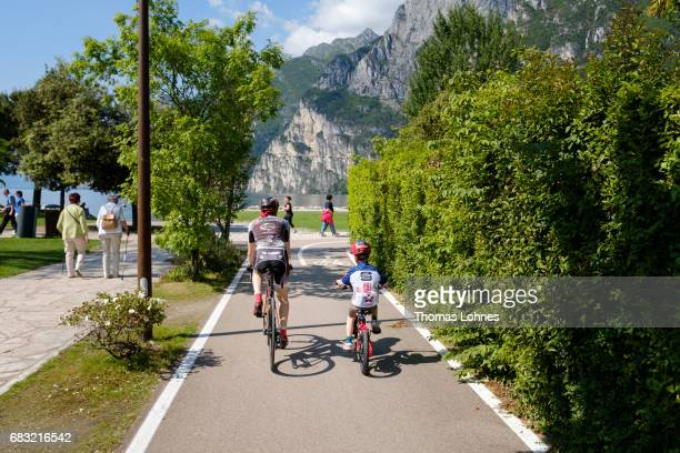 A father and his young son ride their bikes on May 14 2017 near Riva del Garda Italy
