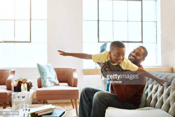 father and i have the best fun indoors - african american family home stock photos and pictures