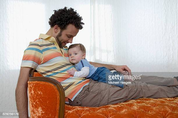 Father and Infant Son on Chaise Lounge