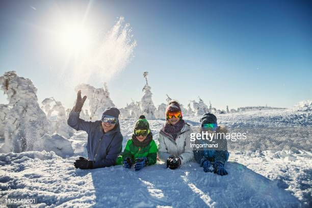 father and kids enjoying ski vacations - winter sport stock pictures, royalty-free photos & images