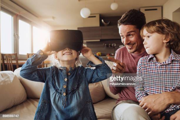 father and kids having a fun with vr - head mounted display stock photos and pictures