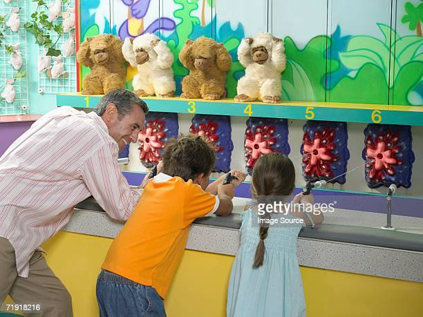 Father and kids on fairground stall