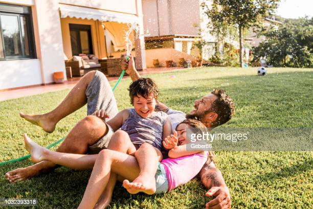 father and kids - grounds stock pictures, royalty-free photos & images