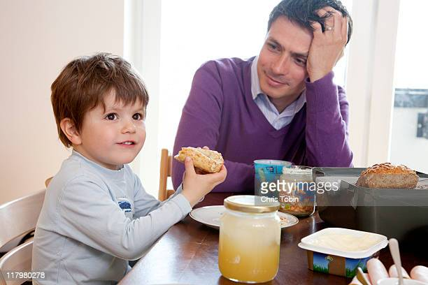 Father and little boy at breakfast