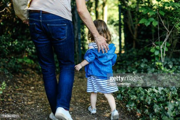 Father and little girl enjoying nature walk