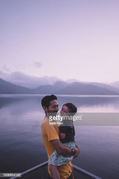 Father and little girl enjoying view together at sunset